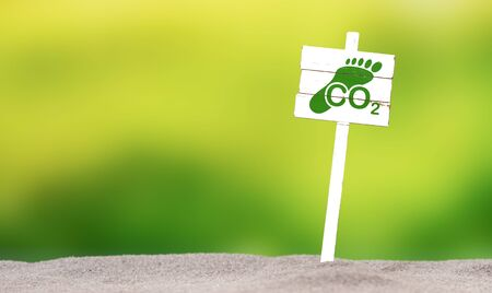 Concept of carbon footprint on a white sign Stock Photo