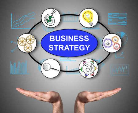 Open hands sustaining business strategy concept Foto de archivo