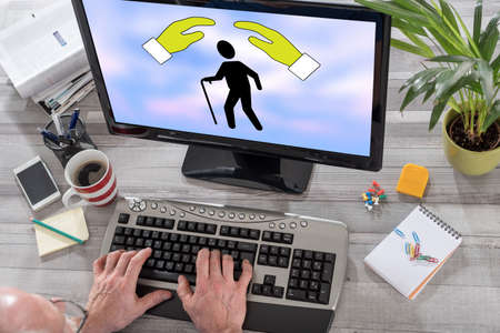 Man using a computer with old age insurance concept on the screen