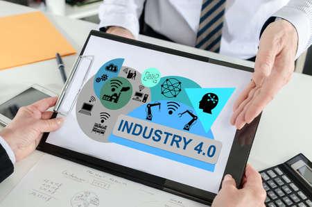 Industry 4.0 concept shown by a businessman Archivio Fotografico