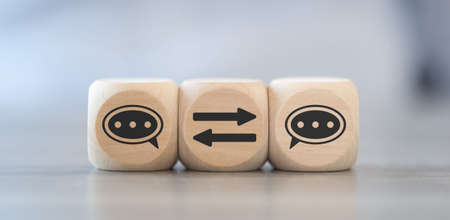 Concept of communication on wooden cubes