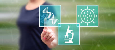 Woman touching a biotechnology concept on a touch screen with her finger Stok Fotoğraf