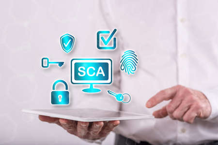Sca concept above a tablet held by a man in background