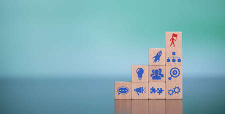 Concept of leadership with icons on wooden cubes