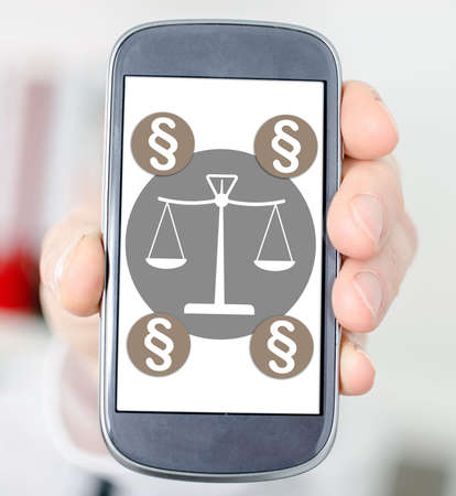 Hand holding a smartphone with law concept