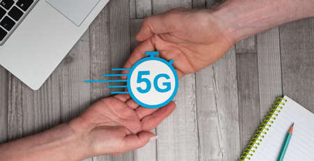 Hands holding a 5G sign; Concept of 5G