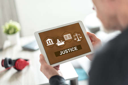 Tablet screen displaying a justice concept