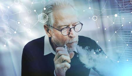 Portrait of senior man smoking electronic cigarette; light effect