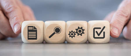 Concept of validation with icons on wooden cubes