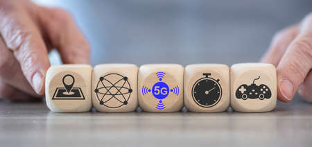Concept of 5G with icons on wooden cubes