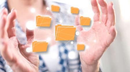 Data exchange concept between hands of a woman in background Archivio Fotografico