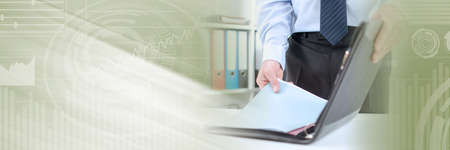 Businessman taking folder from his briefcase at office; panoramic banner Archivio Fotografico