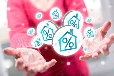 Interest rates concept above the hands of a woman in background