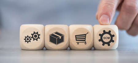 Concept of SCM with icons on wooden cubes Stock Photo