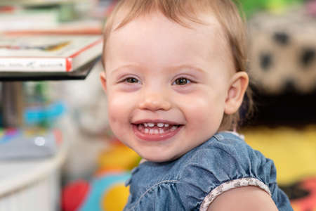 Portrait of happy cute baby girl with a beautiful smile