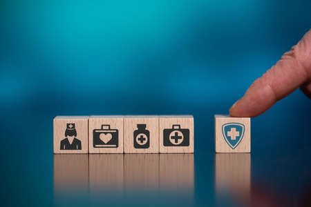 Concept of health protection with icons on wooden cubes