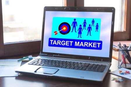 Laptop screen displaying a target market concept Imagens