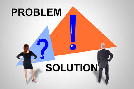Problem and solution concept drawn on a wall watched by business people