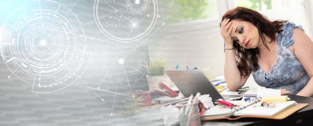 Overworked young businesswoman sitting at a messy desk; panoramic banner Фото со стока