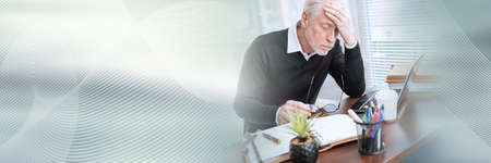 Portrait of overworked senior businessman sitting in office; panoramic banner