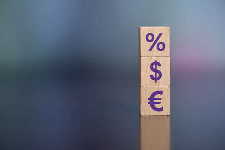 Concept of interest rates with icons on wooden cubes