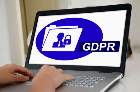 Hands on a laptop with screen showing gdpr concept Stockfoto
