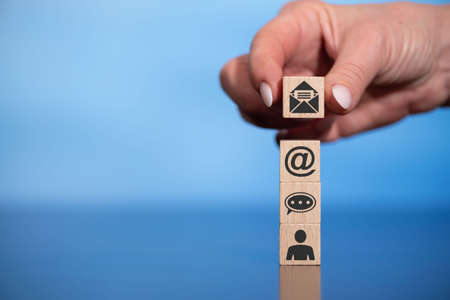 Concept of email sending with icons on wooden cubes