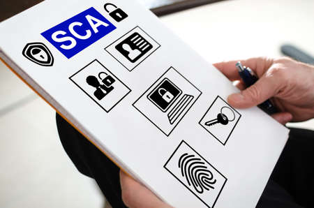 Sca concept on a paper held by a hand