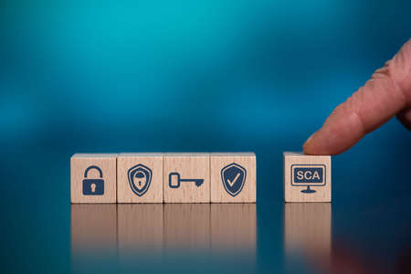 Concept of SCA with icons on wooden cubes Reklamní fotografie