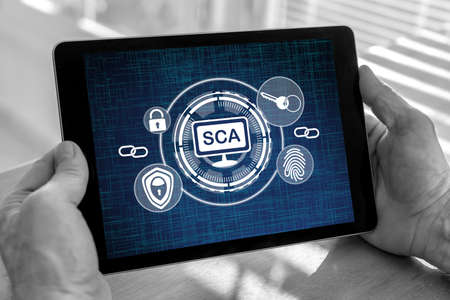Male hands holding a tablet with sca concept