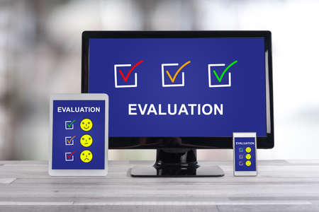 Evaluation concept shown on different information technology devices