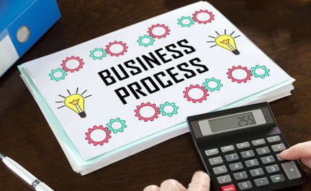 Business process concept illustrated on a paper with a calculator
