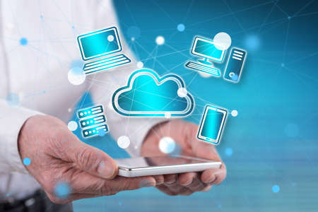 Cloud computing concept above a smartphone held by hands