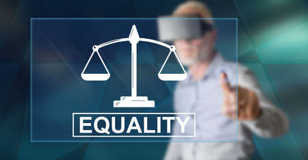 Man with vr headset touching an equality concept on a touch screen with his finger Zdjęcie Seryjne