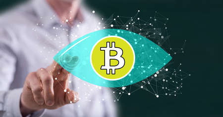Man touching a bitcoin concept on a touch screen with his finger Stock Photo