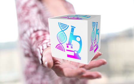 Dna technology concept above the hand of a woman in background