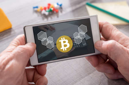 Bitcoin concept on mobile phone