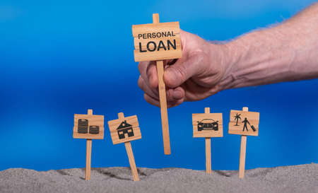 Concept of personal loan with icons on wooden signs