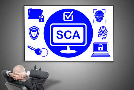Relaxed businessman looking at sca concept on a whiteboard