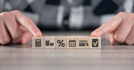 Concept of accounting with icons on wooden cubes