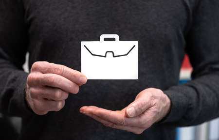 Man holding a paper briefcase; Concept of job loss insurance