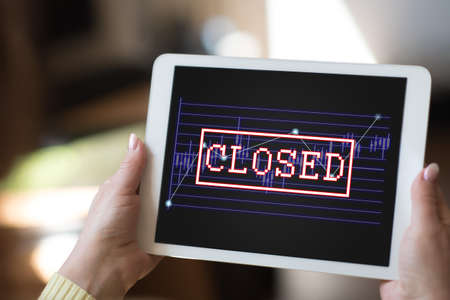 Tablet screen displaying a closed stock market concept
