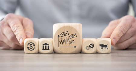 Wooden blocks with symbol of stock market concept