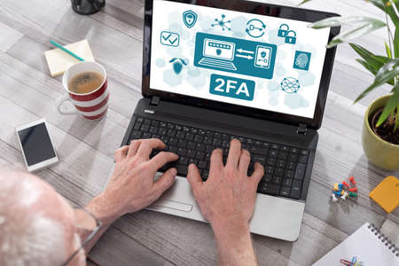 2fa concept shown on a laptop used by a man