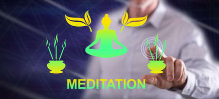 Man touching a meditation concept on a touch screen with his finger