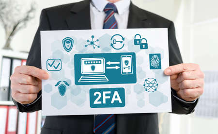 Paper showing 2fa concept held by a businessman