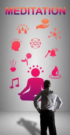 Businessman watching a meditation concept drawn on a wall