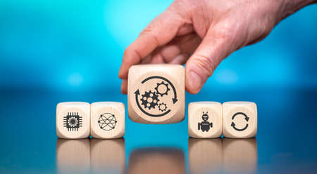Wooden blocks with symbol of automation concept on blue background Imagens