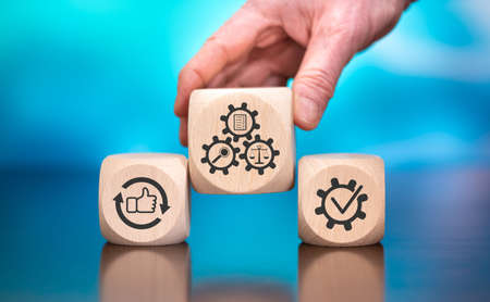 Wooden blocks with symbol of assessment concept on blue background
