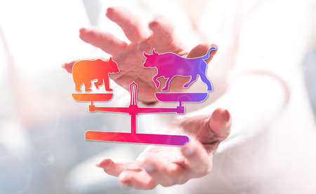 Stock market concept between hands of a woman in background